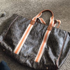 Michael Kors brown leather tote with orange stripe